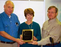 picture of Joan and John Black receiving Award from Steve Barber
